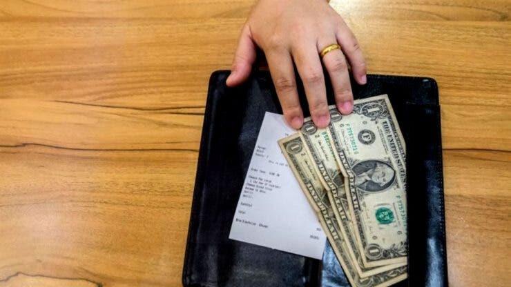 Câți bani a primit o chelneriță din SUA